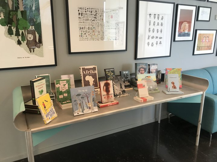 Spring's selected titles on display at NORLA's premises. The table is from the collection of furniture of Norway's Guest of Honour pavilion at the 2019 Frankfurter Buchmesse, all designed by manthey kula and LCLA Office. (Photo: Ellen Trautmann Olerud).