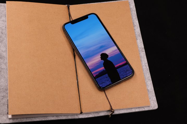 Book and phone photo todd jiang unsplash 8eoqj88jv4s